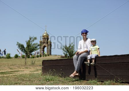 Mother with her son sitting on bench