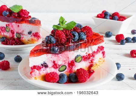Homemade cheesecake with fresh raspberries blueberries and mint for dessert. healthy food. close up