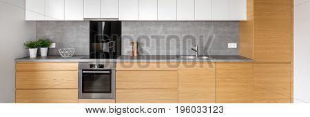 Kitchen With Concrete Wall