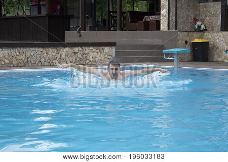 Man swimming in a pool. concept of swimming. Breaststroke