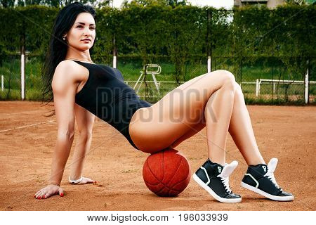 A Beautiful Young Free Sports Sexy Girl Dressed In Bodysuit, Sneakers, With A Smart Ass And Long Leg