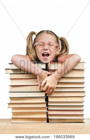 Student leans against stacks of books and laughs opening her mouth isolated against a white background