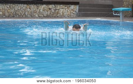 boy alone drowning in the pool. concept of water danger.