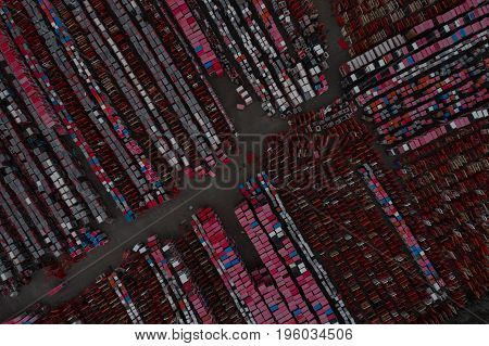 Warehouse containers in red on the street in the open air. Logistics center. Aerial view. From above
