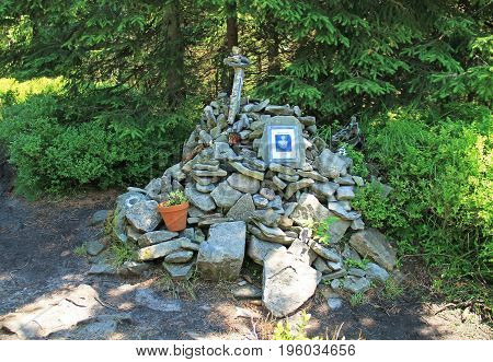 barrow of stones in the nature on Smrk Hill, Beskydy mountains, Czech Republic