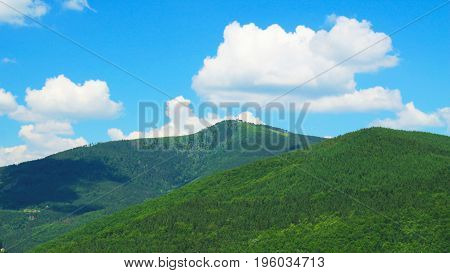 landscape of Beskydy mountains with green forests on sunny summer day