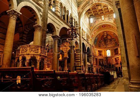 Pisa Italy,November 3rd 2010.The Duomo interior of the church next to the Leaning tower in Pisa Italy.Awesome ornate interior with mosaics,pillars,altar and the cross all make up the foundation for the Catholic church.