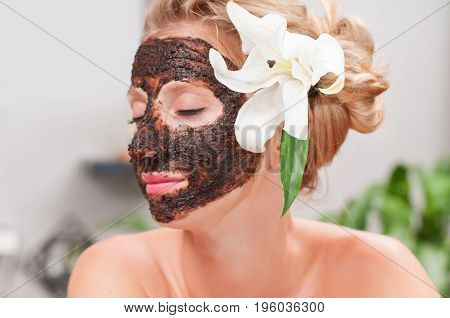 Spa Salon. Beautiful Woman With Facial Mask At Beauty Salon