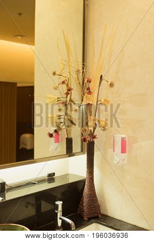 Part of decoration corner inside public washroom. Interior design