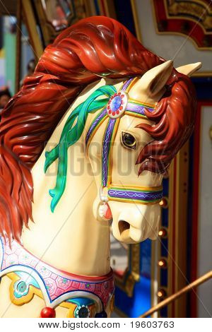 Carousel horse ride at amusement park