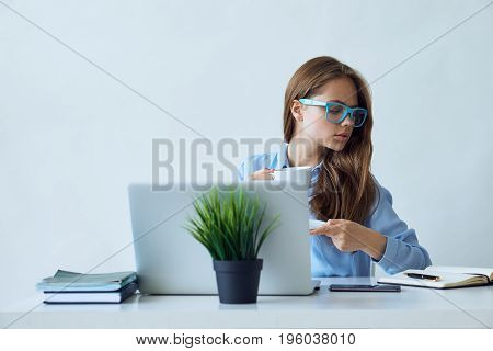 Young beautiful woman working at computer in office.