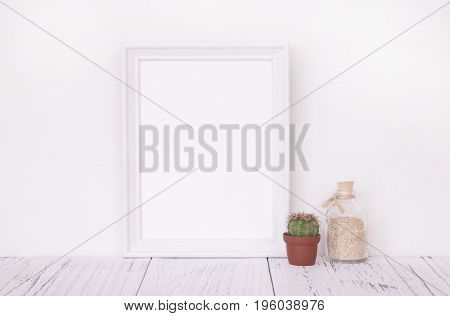 Stock Photography Of Retro White Frame Template Vintage Wood Table And Glass Sand Bottle Cactus