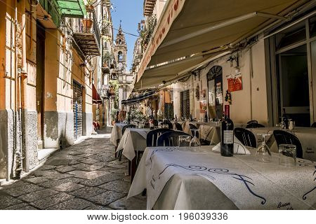 Palermo.Italy.May 26 2017.Pedestrian street and cafés in the historic centre of Palermo . Sicily