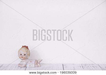 Stock Photography Retro White Wall Wooden Vintage Paint Floor And Ceramic Doll Toy Cute Baby