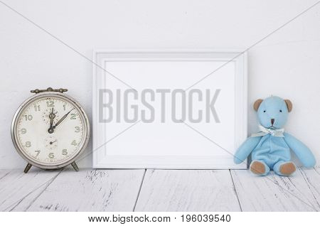 Stock photography white frame vintage painted wood table cute blue bear antique alarm clock