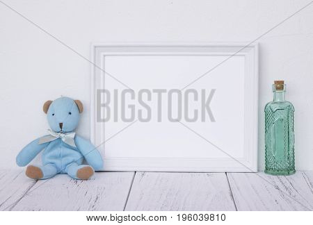 Stock Photography White Frame Vintage Painted Wood Table Cute Blue Bear Green Glass Bottle