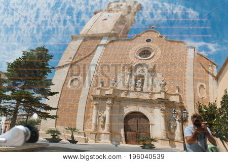 Reflection Of The Church Of Santa Maria Assumpta In Les Borges Del Camp In The Window Of The Car, Ta