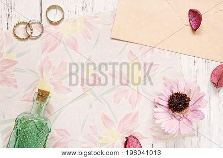 Flat Lay Stock Photography Flower Pattern Letter Envelope Rings Purple Flower Petals Green Glass Bot