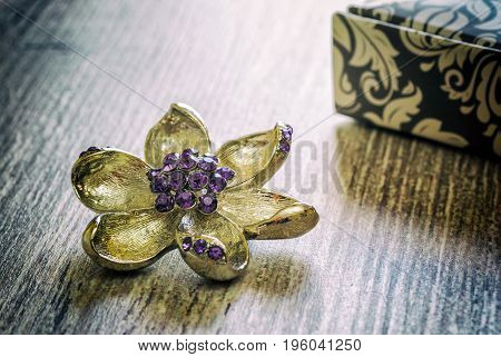 Jewelry for women silver brooch flower modern fashion amulets precious products close-up retro style selective focus