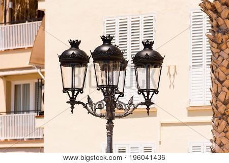 A street lamp close-up against a building background in Sitges Barcelona Catalunya Spain