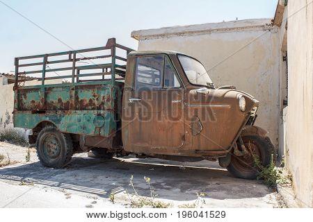 the image old three-wheeled truck, retro car