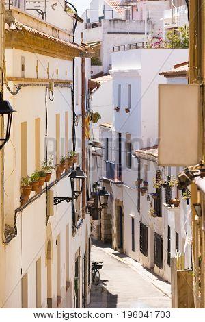 Little Street Of The Historic City Center Sitges, Barcelona, Catalunya, Spain. Vertical.