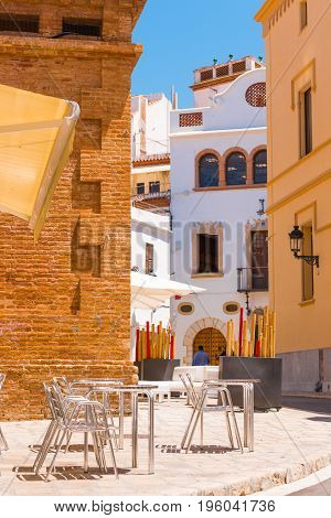 Cafe In The Historical Part Of The City Sitges, Barcelona, Catalunya, Spain. Vertical.