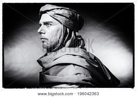 Vintage Black And White Photo Of Profile Of Berber Man Wearing Turban With Robe. Studio Shot.