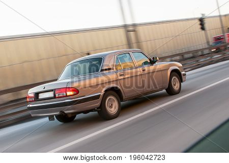 Close view of vehicle driving at high speed through an expressway