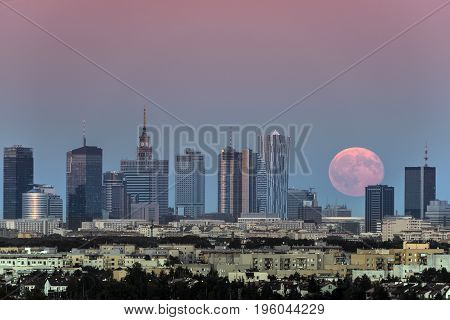 Rising moon over Warsaw city in summer time