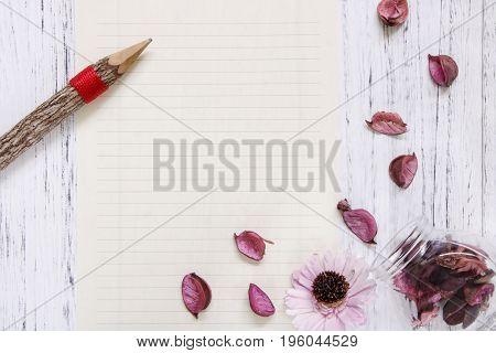 Flat Lay Stock Photography Purple Flower Petals Glass Bottle Wood Pencil