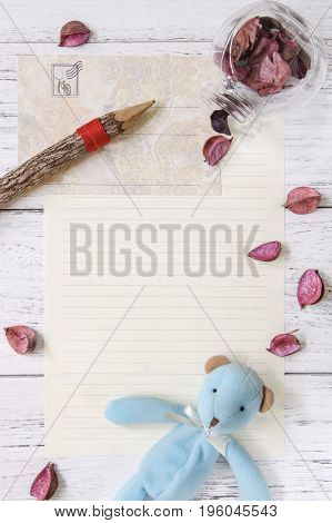 Flat Lay Stock Photography Purple Flower Petals Letter Envelope Paper Glass Bottle Bear Doll Wood Pe