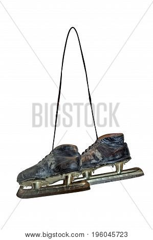 Old shabby retro ice skates hanging on shoelaces isolated on white background