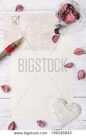 Flat Lay Stock Photography Purple Flower Petals Letter Envelope Paper Glass Bottle Wood Pencil Heart