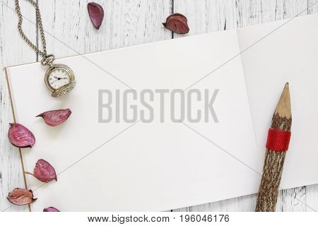 Stock Photography Flat Lay Vintage White Painted Wood Table Purple Flower Petals Pocket Clock Pencil
