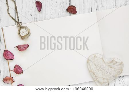 Stock Photography Flat Lay Vintage White Painted Wood Table Purple Flower Petals Pocket Clock Heart