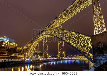 The bridge Don Luis across the Douro River in the night illumination. Porto. Portugal.