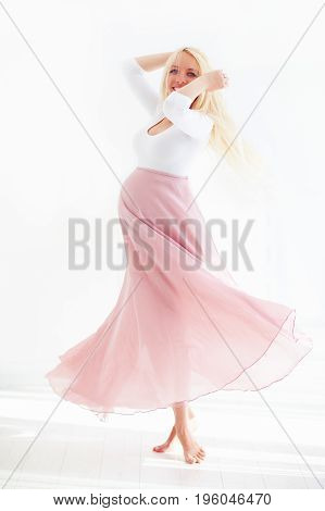 Beautiful Pregnant Woman Swirling With Happiness, In Pretty Flower Dress