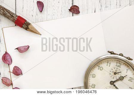 Stock Photography Flat Lay Vintage White Painted Wood Table Purple Flower Petals Vintage Alarm Clock