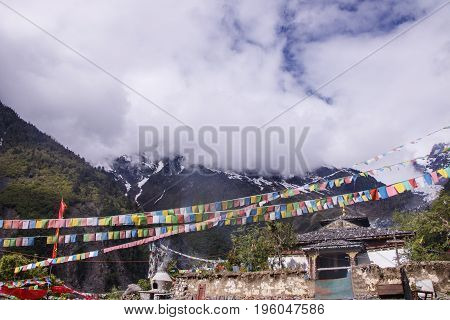 Meili Snow Mountain Also Know As Kawa Karpo Located In Yunnan Province, China Decorated With Colorfu