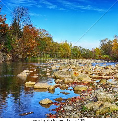 rocky shore of the river. Autumn time