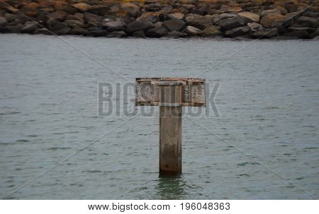 horizontal image of steel letter T in water