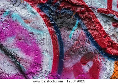 Abstract wall close-up. Detail of a graffiti . Fragment for background, stylish pattern, fashion colors
