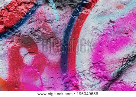 Abstract beautiful street art colorful graffiti style closeup. Detail of wall. Can be useful for backgrounds, stylish pattern, fashion colors