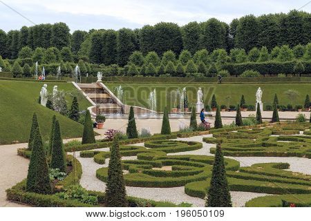 HILLEROD, DENMARK - JUNE 30, 2016: It is the Baroque-style Frederiksborg Castle Gardens.