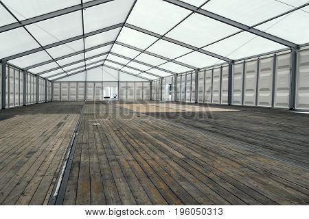Large Exhibition Tent with glass door in Summer - Outdoor shot.