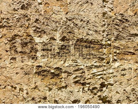 Abstract Background Of The Old Wall Of Black Natural Stone With Cracks And Scratches. Landscape Styl