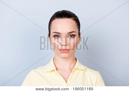 Close Up Portrait Of Serious Young Freelancer Brunette Lady, She Stands In Yellow Tshirt On Pure Lig