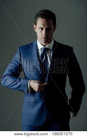 Business Fashion, Businessman Buttoning Button On Elegant Blue Formal Suit