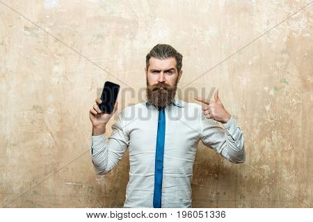 Bearded Man Or Hipster With Long Beard Hold Phone